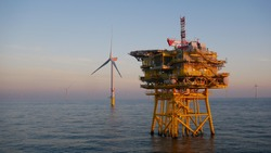 Offshore wind farm substation with turbine in North Sea