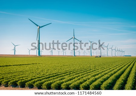 Offshore Windmill farm in the ocean  Westermeerwind park , windmills isolated on a beautiful bright day Netherlands Flevoland Noordoostpolder Stock photo ©