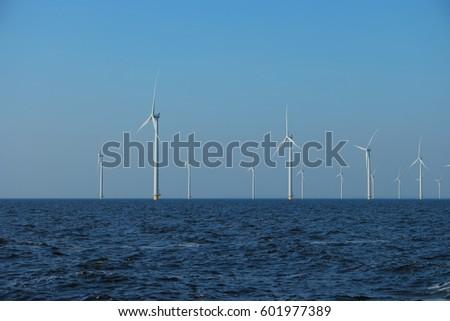Offshore Windmill farm Westermeerwind park by Urk,Netherlands Flevoland Noordoostpolder March 2017 #601977389