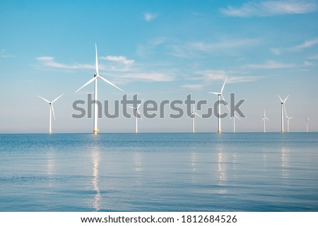 offshore windmill park with stormy clouds and a blue sky, windmill park in the ocean. Netherlands Europe Stock photo ©