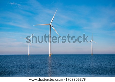 offshore windmill park with stormy clouds and a blue sky, windmill park in the ocean. Netherlands . Europe, windmill turbines in ocean with blue sky, green energy concept Сток-фото ©
