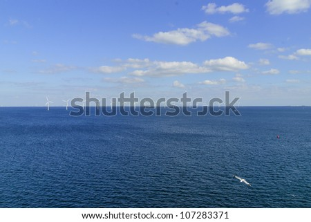 Offshore windmills in sea off Denmark