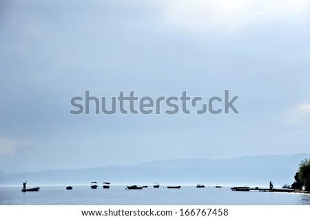 OHRID, MACEDONIA, MAY 18, 2011. Silhouettes of boats in lake Ohrid.