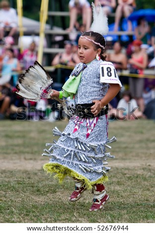OHSWEKEN, ONTARIO, CANADA -JULY 27: A young Jingle Dress Dancer performs during the Grand River Champion of Champions Powwow July 27, 2008 in Ohsweken, Ontario, Canada.