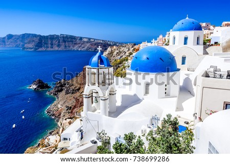 Oia, Santorini, Greece. Famous attraction of white village with cobbled streets, Greek Cyclades Islands, Aegean Sea.