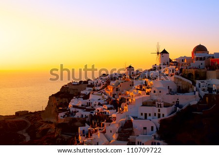 OIA, SANTORINI, GREECE - JULY 10: Sunset at Oia village on July 10, 2010 in Santorini, Greece. Santorini is that remains after an enormous volcanic explosion and created the current geological caldera