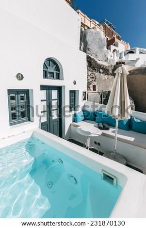 OIA, SANTORINI, GREECE - NOVEMBER 3: swimming pool in inner yard of vacation house in Oia, Santorini, Greece on November 3, 2014.