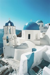 Oia Santorini view of buildings and blue skies.Sunny day