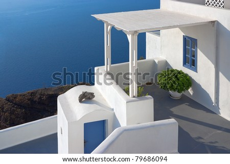Oia village in Santorini island in Greece. (View of the sea and the village)