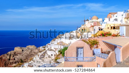 Oia village, Santorini island, Greece, on a bright day, panoramic image #527284864