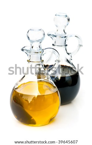 Oil and balsamic vinegar glass bottles isolated on white
