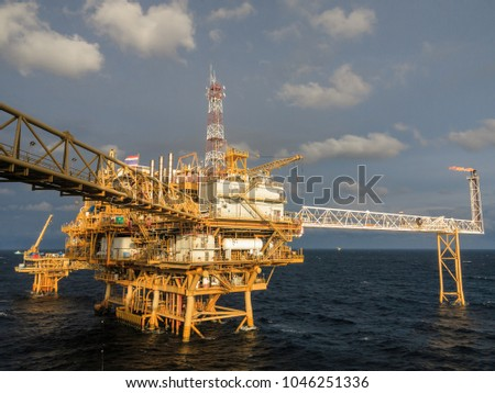 Oil and Gas central processing platform and remote platform produced natural gas and liquid condensate for set to onshore refinery #1046251336