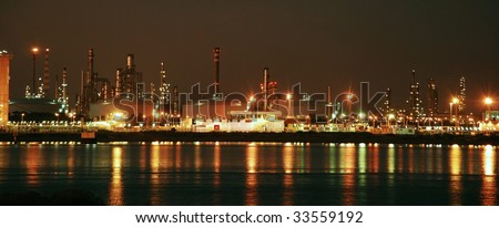Oil and gas factory big rafinery by night. Panorama.