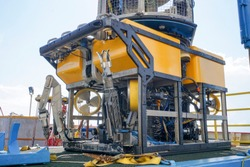 Oil and gas industrial. A commercial Remote Operated Vehicle (ROV) for deep sea survey purpose standby on the mini platform awaiting for launching to the sea.