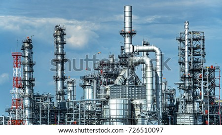 Oil and gas industrial,Oil refinery plant form industry,Refinery factory oil storage tank and pipeline steel with sunset and cloudy sky background,Thailand stock photo
