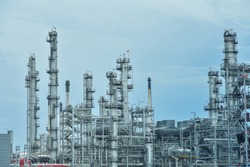 Oil and gas industrial, Oil refinery plant from industry, Refinery Oil storage tank and pipe line steel with blue sky
