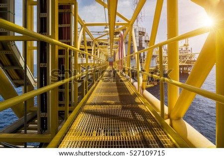 Oil and gas industrial platform walk way in the gulf or the sea, The world energy of oil and gas company, Offshore oil and rig construction.