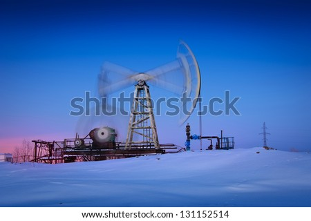 Oil and gas industry. Pump jack at blue sky background.