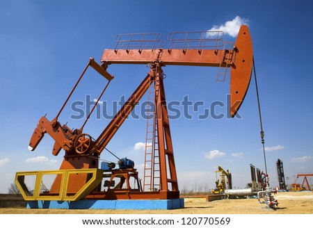 Oil and gas industry. Work of oil pump jack on a field. #120770569