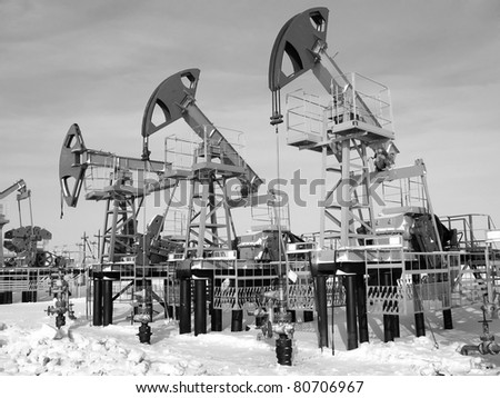 industry. Work of oil pump jack on a oil field.. Black and white ...