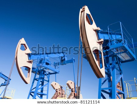 Oil and gas industry. Work of oil pump jack on a oil field. Wide Angle