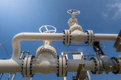 Oil and gas processing plant with pipe line valves.Industrial zone, Steel pipelines and valves blue sky.Oil pipeline valves in the oil and gas industry.