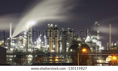 Oil and gas refinery at twilight with reflection - factory - petrochemical plant