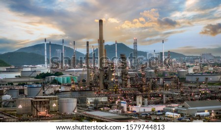 Oil and gas refinery or petrochemical industry on the sunset background, heavy equipment of the manufacturing industry of the petrochemical industry #1579744813