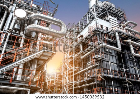 Oil and gas refinery plant form industry petroleum zone,Refinery equipment pipeline steel and oil storage tank at sunrise. -image