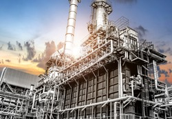 Oil and gas refinery plant form industry petroleum zone,Refinery equipment pipeline steel at sunrise. -image
