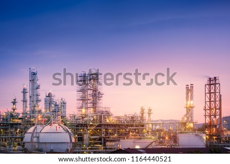 Oil and gas refinery plant or petrochemical industry on sky sunset background, Factory with evening, Gas storage sphere tank in petrochemical industrial #1164440521