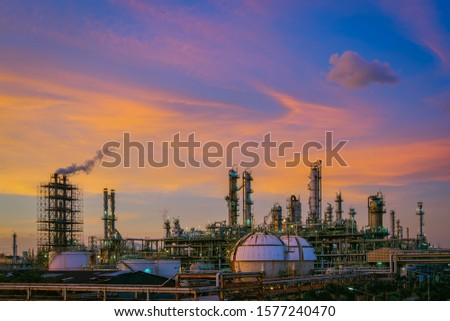 Oil and gas refinery plant or petrochemical industry on sky sunset background, Factory with evening, Manufacturing of petrochemical industrial #1577240470
