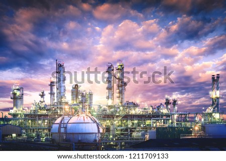 Oil and gas refinery plant or petrochemical industry on sky sunset background, Gas storage sphere tank and distillation tower in petroleum industrial #1211709133