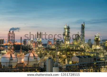 Oil and gas refinery plant or petrochemical industry on sky sunset background, Gas storage sphere tank and distillation tower in petroleum industrial