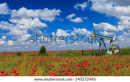 Oil and gas well in rural countryside with