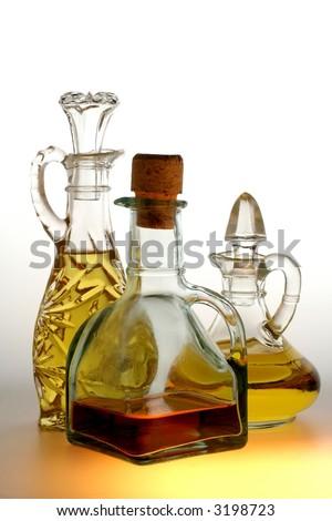 Oil and vinegar bottles on white background.
