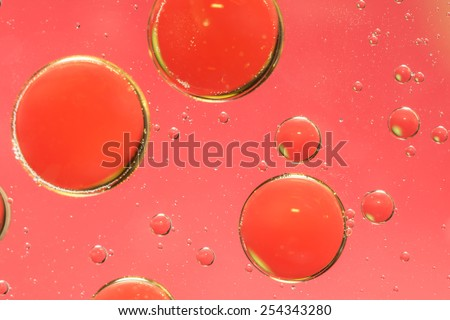 Oil and water abstract in grungy pink and red