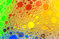Oil and water with color background creating dreamy smooth diffraction