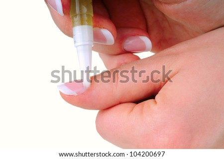 Oil applying on nail as a part of manicure