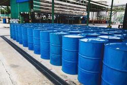 Oil barrels blue or chemical drums vertical stacked up industry