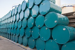 Oil barrels green or chemical drums horizontal stacked up
