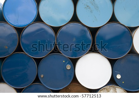 oil barrels  or chemical drums stacked up for cargo - stock photo