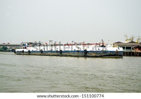Oil boat on the river - stock photo