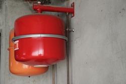 Oil boiler red balloon installation in the garage