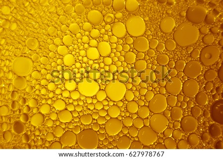 Oil bubbles and water bubles abstract on yellow and orange background