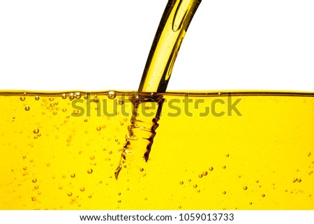 Oil car motor or vegetable oil pouring with bubble isolated on white background