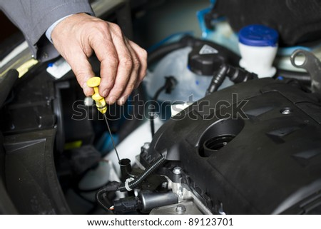 Oil change at the car shop - stock photo