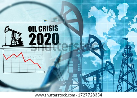 Oil crisis 2020. Concept - falling demand has led to crises. Problems in fuel market led to a crisis. Graph shows a drop in oil demand. Fall in oil prices led to global crisis. Continents. Magnifier