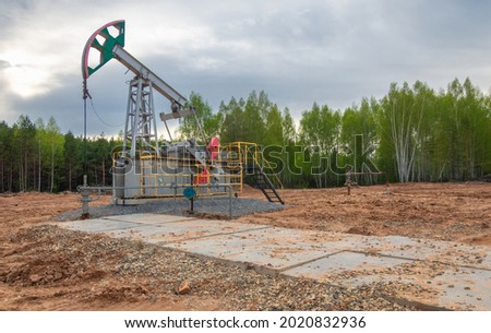 Oil deposit. Pump jacks, which are known as nodding donkeys. Crude oil is found in all reservoirs formed in the earth's crust from the remains of once living creatures Сток-фото ©