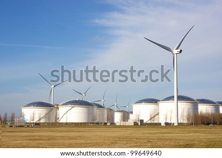 oil depot and storage tanks with wind turbine for clean energy